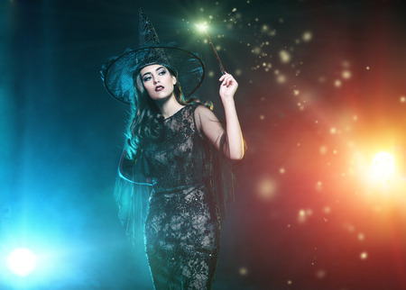 A beautiful lady in a costume of witch. Halloween. Celebration. Stok Fotoğraf - 109269914