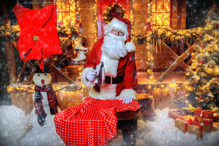 Portrait of Santa Claus ironing cloth. Christmas and New Year concept.