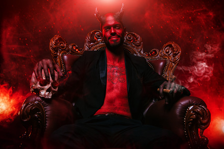 A portrait of a bad demon in his throne. Horror movie, nightmare. Halloween.
