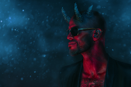 A portrait of a bad demon in sunglasses. Horror movie, nightmare. Halloween. 스톡 콘텐츠 - 110944713