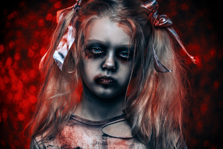A close-up portrait of a scary girl. Halloween. Horror film.