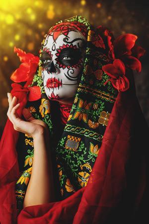 A close-up portrait of Calavera Catrina. Sugar skull makeup. Dia de los muertos. Day of The Dead. Halloween. Stock Photo