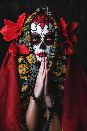 A close-up portrait of Calavera Catrina. Sugar skull makeup. Dia de los muertos. Day of The Dead. Halloween. Banco de Imagens
