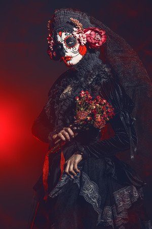 Calavera Catrina in darkness. Sugar skull makeup. Dia de los muertos. Day of The Dead. Halloween. 스톡 콘텐츠