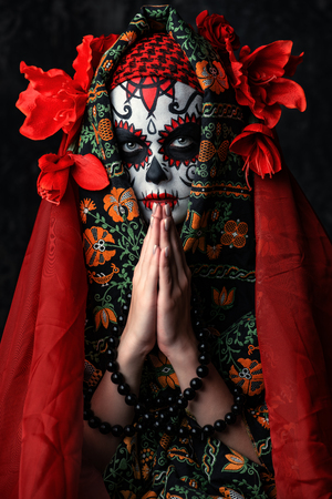 A close-up portrait of Calavera Catrina. Sugar skull makeup. Dia de los muertos. Day of The Dead. Halloween. 写真素材
