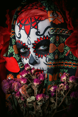 A close-up portrait of Calavera Catrina. Sugar skull makeup. Dia de los muertos. Day of The Dead. Halloween. 스톡 콘텐츠
