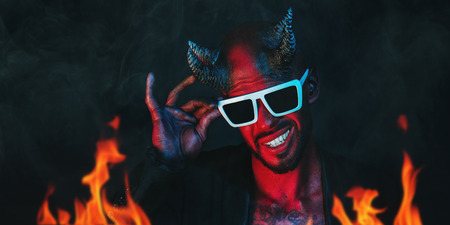 A portrait of a bad demon in sunglasses. Horror movie, nightmare. Halloween. 스톡 콘텐츠 - 110724335