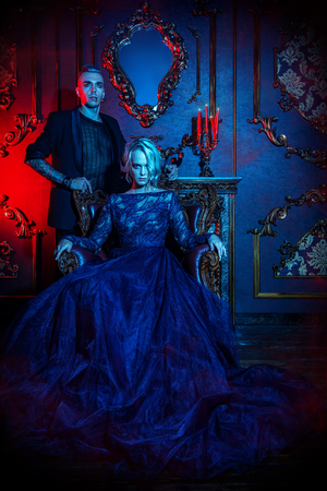 A beautiful couple of vampires is in a dark room. Classic style. Beauty, fashion. Stok Fotoğraf