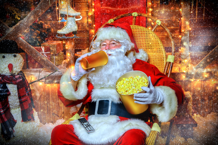 Portrait of Santa Claus eating pop corn. Christmas and New Year concept.