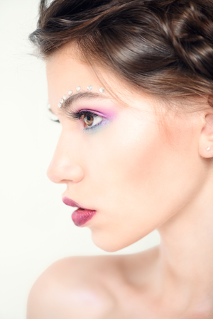 Make-up and cosmetics concept. Beauty portrait of a sexual woman with bright make-up. White background. 스톡 콘텐츠 - 111008595