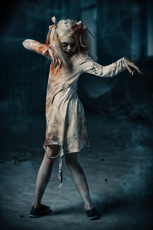 A full length portrait of a scary zombie girl. Halloween. Horror film.