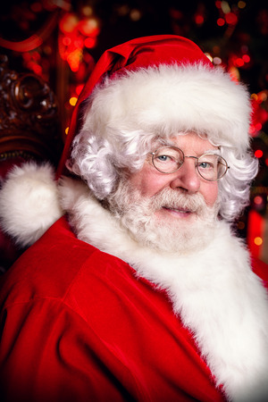 A close-up portrait of Santa Claus. Miracle time. Merry Christmas and Happy New Year.