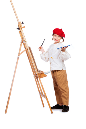A full length portrait of a girl painting a picture. Creativity, artist.