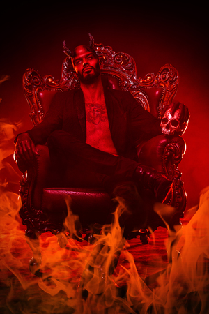 A portrait of a bad demon in his throne. Horror movie, nightmare. Halloween. 写真素材 - 111750417