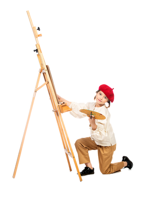 A full length portrait of a girl painting a picture. Stock Photo