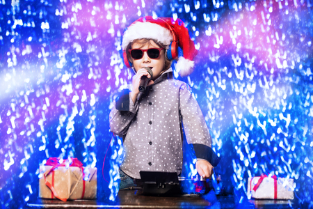 A young dj playing music in sunglasses. Merry Christmas and Happy New Year. Stock fotó