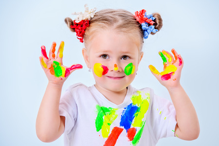 A portrait of a cute girl in colorful paints. Childhood, leisure activities. Stok Fotoğraf - 112449164