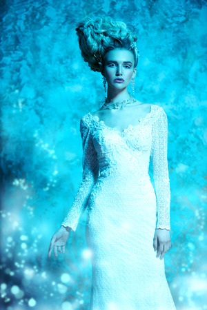 A portrait of a cold beautiful lady wearing a tight dress. The snow Queen. Beauty,cosmetics, hairstyle, fashion. Stock Photo - 112449187