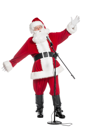 A portrait of Santa Claus with a microphone. Merry Christmas and Happy New Year! Reklamní fotografie