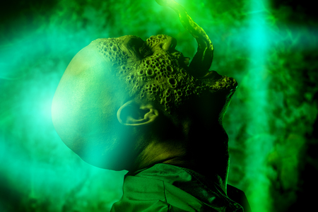 A portrait of a sick screaming man in the green light. Desparation, hopelessness. Stock Photo
