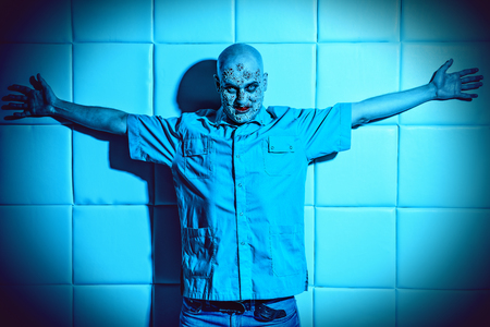A portrait of a sick man in the blue light. Desparation, hopelessness. 스톡 콘텐츠