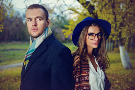 Close-up portrait of a beautiful young people walking in the autumn park. Autumn fashion. Stock Photo