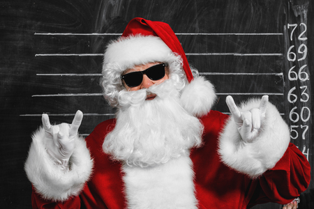 A portrait of cool Santa Claus in sunglasses. Merry Christmas and Happy New Year!