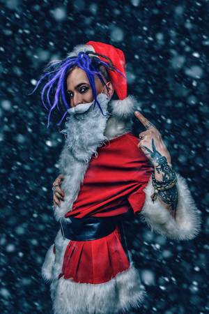 Portrait of a cool punk Santa Claus with bright dreadlocks over . Stock Photo