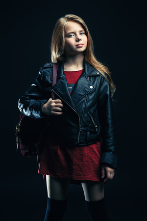 A portrait of a bright cute schoolgirl. Fashion for active kids.