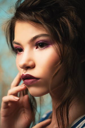 Close-up portrait of a attractive girl posing in studio. Beauty, fashion. Make-up and cosmetics concept.