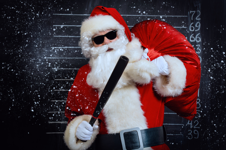 A portrait of criminal Santa Claus in sunglasses. Merry Christmas and Happy New Year! Stock Photo
