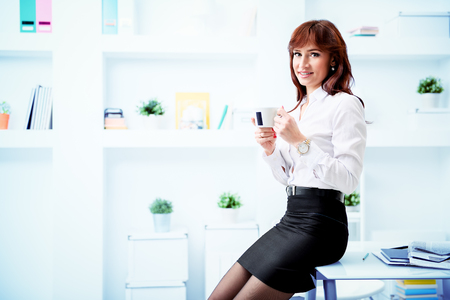 A portrait of a beautiful woman at the workplace. Beauty, fashion. Work, education.