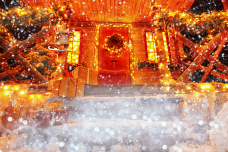 A porch decorated with luminous garlands for Christmas at home. Decorations for Christmas and New year. Magic miracle time.