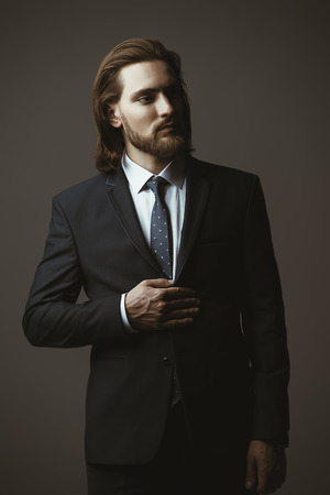 Fashion shot. Handsome young man posing in elegant suit and white shirt. Mens beauty, fashion.