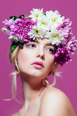 Close-up portrait of a sensual spring lady in a wreath of flowers. Beauty, cosmetics. Make-up.