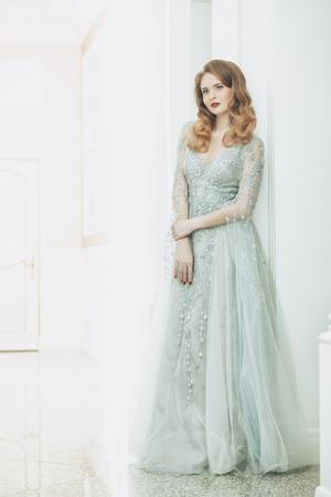 A portrait of a beautiful elegant woman in the fluttering wedding dress. Fashion, wedding dress.