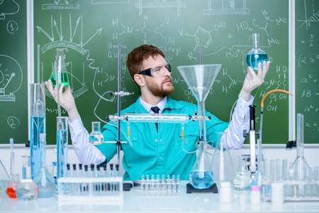 Smart man scientist making chemical experiments in the laboratory. Educational concept. Discovery.
