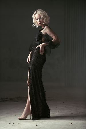 A full length portrait of a beautiful blonde lady. Evening dress. Fashion, beauty.