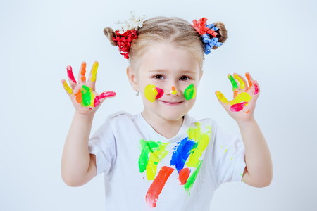 A portrait of a cute girl in colorful paints. Childhood, leisure activities. Stok Fotoğraf - 116128215