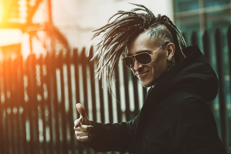 Portrait of a punk man on the street. Fashion, subculture.