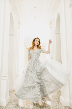 A portrait of a beautiful elegant woman in the fluttering wedding dress. Fashion, wedding dress.