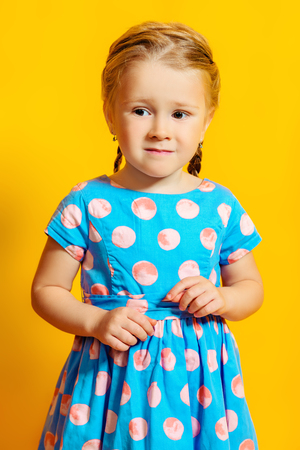 A portrait of a positive young pretty girl. Summer bright fashion for kids. Stock fotó