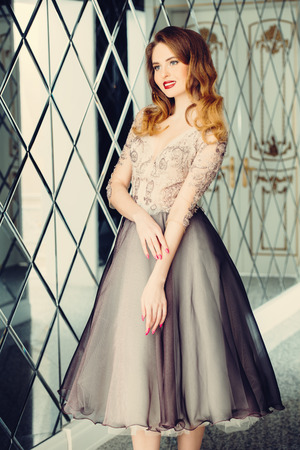 A portrait of a beautiful elegant woman in the evening dress. Fashion, evening dresses for events. Stock Photo