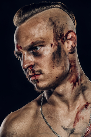 Fight club, MMA. Portrait of a bad guy fighter with a face in the blood. Rocker, punk. Stok Fotoğraf