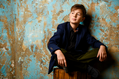 A portrait of a young thoughtful boy. Beauty, fashion, teenagers. Stock Photo