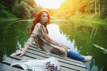 Beautiful hippie girl posing outdoor. Contemporary bohemian style. Spirit of freedom. Fashion shot. Bohemian, bo-ho style.