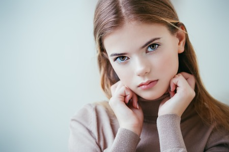 Portrait of a cute girl teenager. Beauty, fashion.