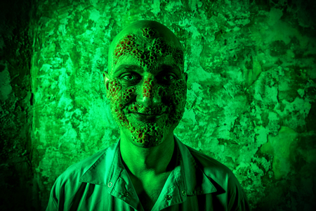 A portrait of a sick scientist after a failed experiment in the green light. Desperation, hopelessness. Horror, halloween. Banco de Imagens