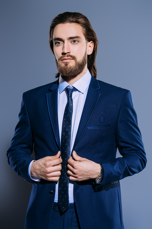 Fashion shot. Handsome young man posing in elegant blue suit and white shirt. Mens beauty, fashion. Stock Photo