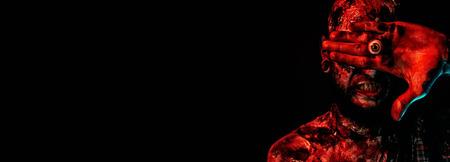 Close-up of a creepy scary zombie. Halloween. Horror film.